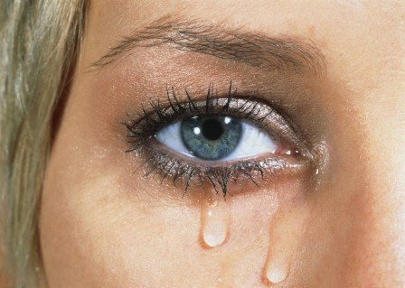 Eye of young woman with tears