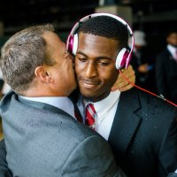 Houston's coach pecks away at football's macho culture, one kiss at a time