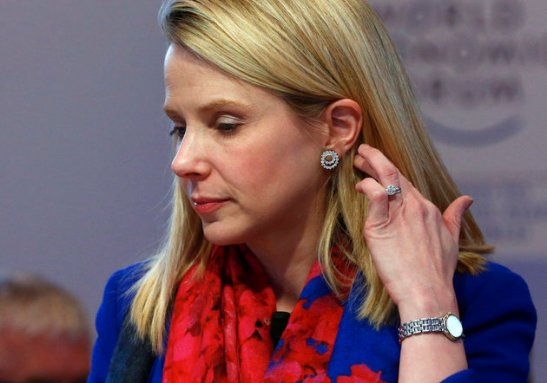 "Yahoo CEO Mayer gestures before the session ""In Tech We Trust"" in the Swiss mountain resort of Davos"