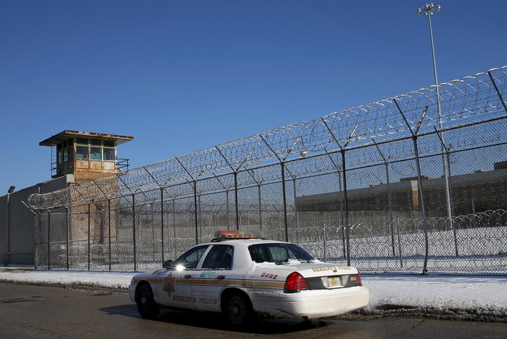 A Cook County Sheriff's police car patrols the exterior of the Cook County Jail in Chicago