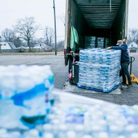Flint residents welcome Nestlé donations. But its ads? Not so much.